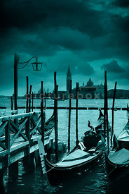 An atmospheric image of a deserted Venice on a stormy, winter night.