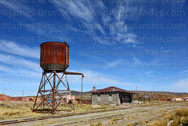 Water tower and disused railway station building in Comanche, La Paz Department, Bolivia