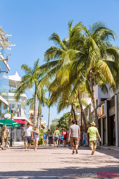 Street in Playa del Carmen at daytime full of tourists, Mexico