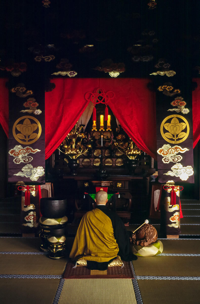 A Zen monk of the Soto School beats a drum in front of the altar at the Seiryu-ji Temple in Hikone City