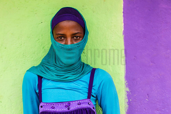 Portrait of a Muslim Woman against a Colorful Wall