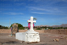 Grave in cemetery next to monument near site of Battle of Topater, Calama, Region II, Chile