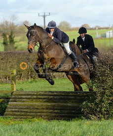 Louise Bevin jumping a tiger trap - The Quorn Hunt at Woodpecker Farm