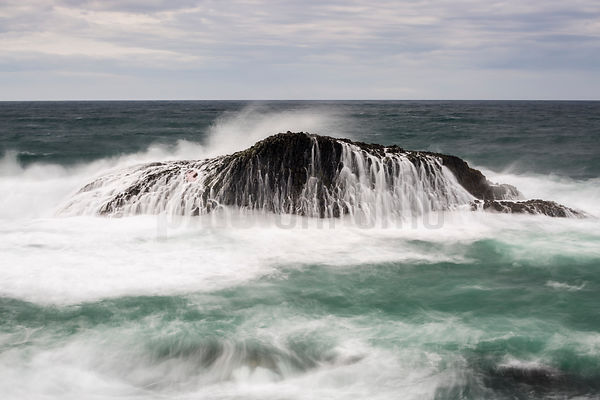 Wave Breaking over Basalt Rock
