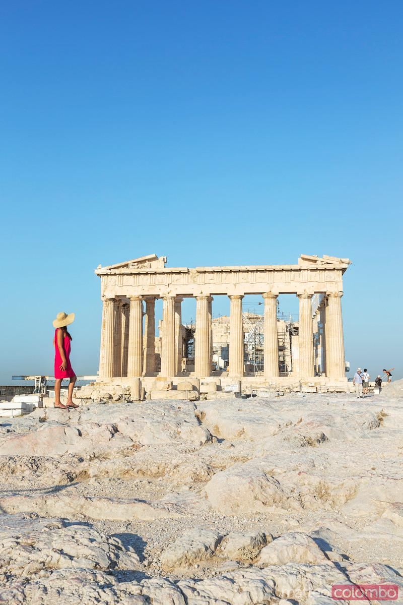 Woman in front of Parthenon temple on the Acropolis, Athens, Greece