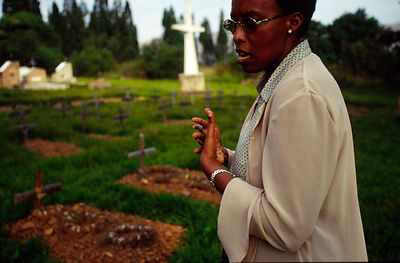 Burundi - Ruyigi - Marguerite Barankitse at the graves of Hutu friends killed at the Bishop's House during the slaughter