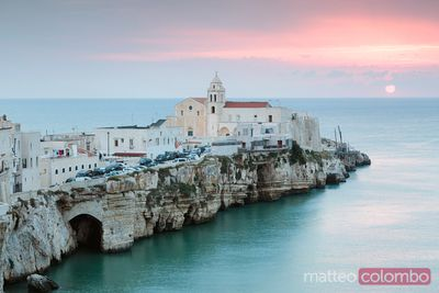 Sunrise over old town of Vieste, Gargano, Puglia, Italy