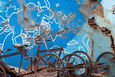 Old bicycles next to a mural near Assi Ghat, Varanasi, India.