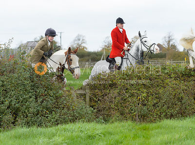 Lexi Taylor, David Bellamy jumping a hedge near the meet in Long Clawson
