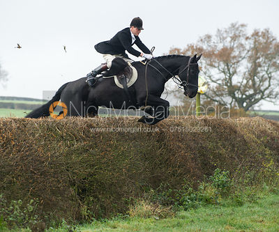 Captain Fred Hopkinson jumping a big hedge