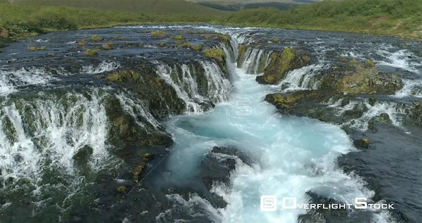 Bruarfoss Glacial Waterfall Iceland Sunny Day Aerial Slow Motion