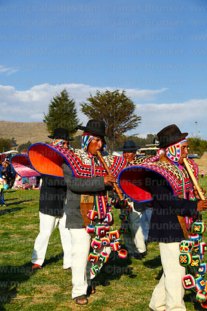 Quena quena musicians in traditional dress playing pinquillos at festival in Compi Tauca, La Paz Department, Bolivia