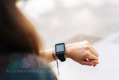 Woman checking her smartwatch