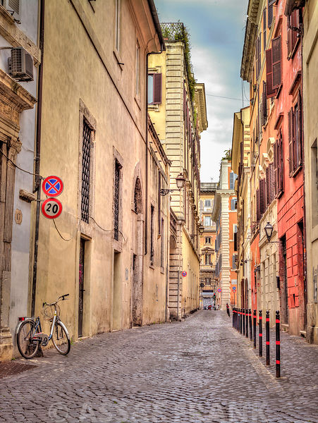 Narrow street through old buildings in Rome, Italy
