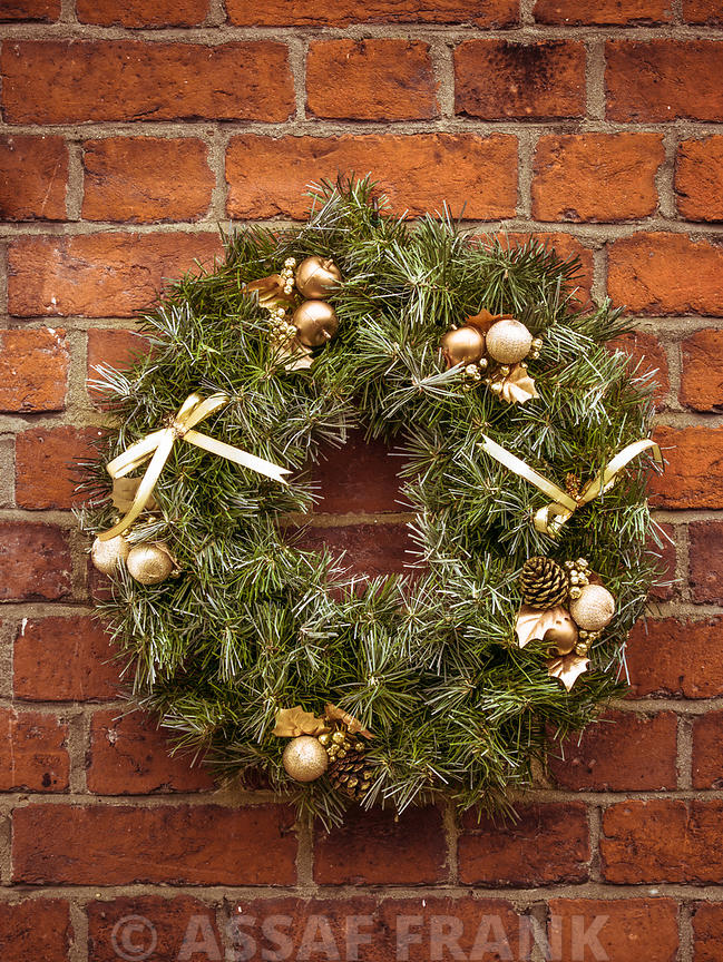 Christmas wreath on a brick wall