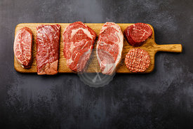 Variety of Raw Black Angus Prime meat steaks Top Blade, Machete, Rib Eye, Striploin, Tenderloin fillet Mignon, Cutlet Burger ...