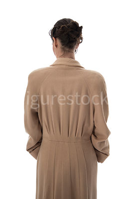 A  vintage 1920s - 1930s woman in coat – shot from eye level.