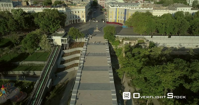 High level aerial camera flies backwards from the Potemkin Stairs showing the Odessa Skyline in the early morning light Ukraine