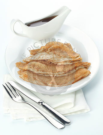 Pancakes with Maple syrup on white background