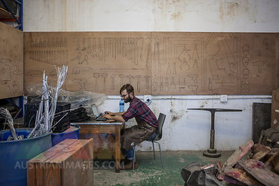Man in workshop using laptop