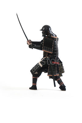 A Samurai warrior with his sword in the air - shot from low-level.