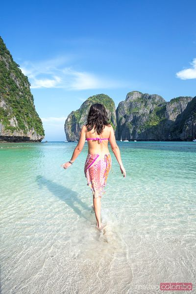 Adult woman in bikini on tropical beach, Thailand