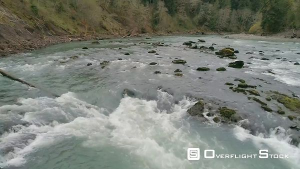 Low flyby across rapids in Hoh River, Washington State