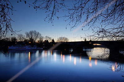 Kew Bridge at Dusk with the lights of the Bridge Reflecting in the River Thames