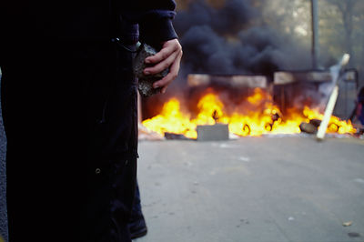 Czech Republic - Prague - Protester beside a burning barracade