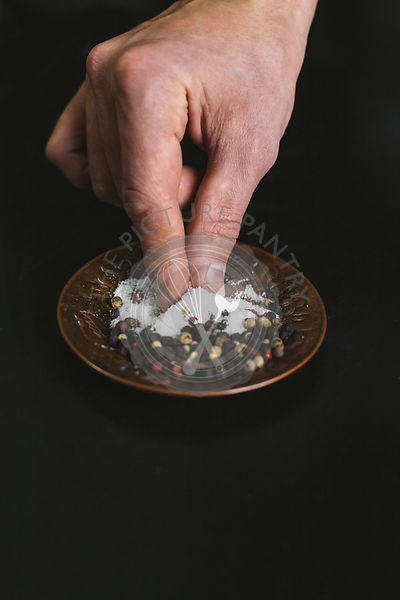 A man taking a pinch of salt