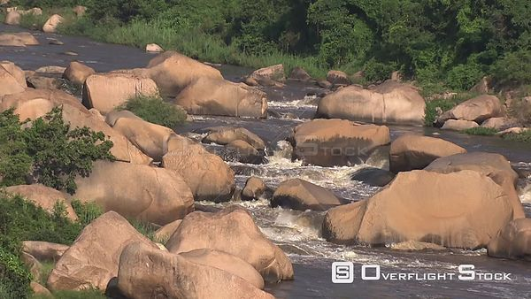 Aerial shot of a river flowing over boulders Nelspruit Mpumalanga South Africa