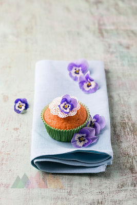 Muffin with Horned Violets on napkin
