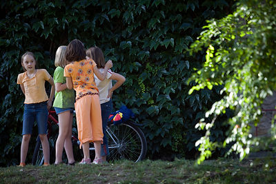 Hungary - Pecs - Girls laugh and gossip in a park