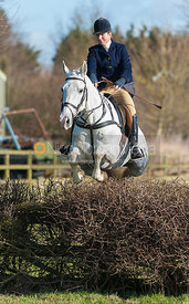Clare Bell jumping the first hedge