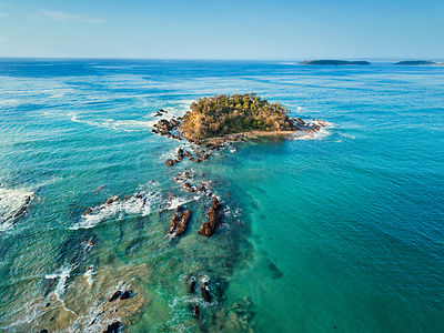 One of the many small  islands off the coast at Batemans Bay Australia