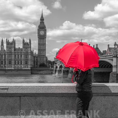 Tourist with Red Umbrella on Thames promenade, London, UK