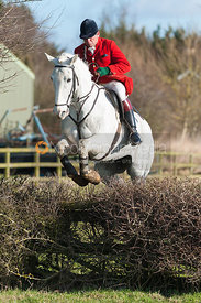 Charlie Gordon-Watson jumping the first hedge