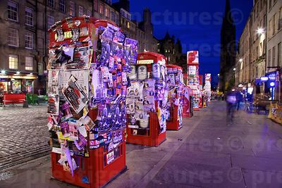 Red Telephone Boxes in Edinburgh High Street Plastered with Fringe Festival Posters