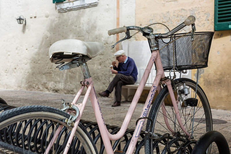 Pink Bianchi Bicycle and a Man Eating Ice Cream
