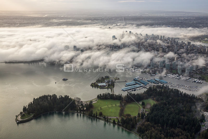 Stanley Park and Downtown Vancouver during a fog covered morning.