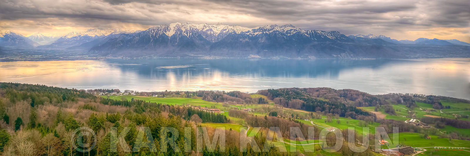 Panorama - Green fields with forests, Geneva Lake and the Alps