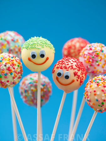 Multi colored popcakes with smiley faces