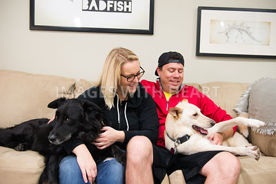 Couple with two dogs on couch