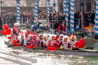 People wearing Valentine Smocks in the Venice Carnival Water Parade  on the Rio di Cannaregio Canal