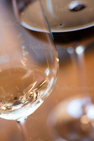 Close-up of white wine glass next to glass of red wine