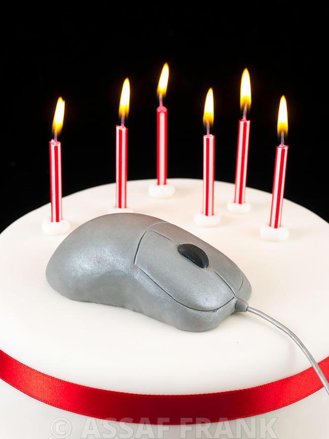 Birthday cake with mouse shaped on top