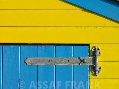 32 Number Sign on Beach hut close-up, Blue Background