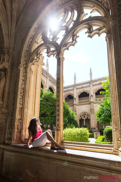 Tourist visiting the cloister of monastery, Toledo, Spain