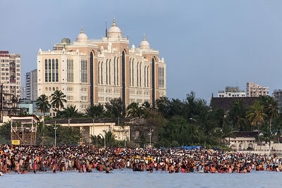 A crowd gathers on Chowpatty Beach to immerse idols of Ganesh in the Arabian Sea during the Ganesh Chaturthi festival. In the...