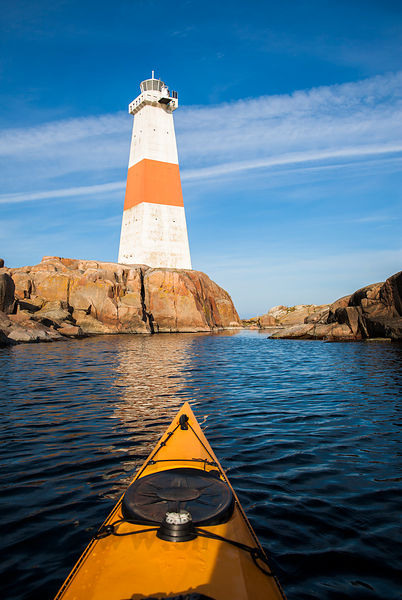 Kayaker and The Lighthouse of Jussarö